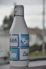 Just in case . . . (LilBooBear) Tags: lait latte milch blueandwhite justincase milkbottle santamightwantmorethanoneglassofmilk charminglittlecow wiredlid