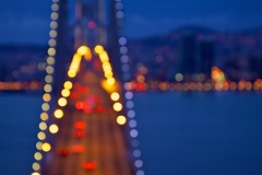 Bay Bridge Bokeh (Chris Saulit) Tags: sf sanfrancisco california city bridge northerncalifornia cali skyline dark dawn lights oakland treasureisland bokeh baybridge bayarea bluehour norcal ybi yerbabuenaisland sfobb heurebleue lheurebleue