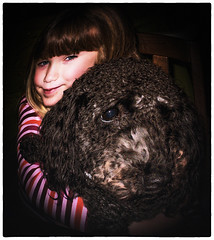 Hold on Tight to your Dreams (jta1950) Tags: portrait dog pet pets cute dogs girl animal kids kid adorable canine fisheye panasonic granddaughter poodle grandchild toypoodle 5yearold blackpoodle miniaturepoodle lx5 dmclx5