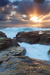 Stormy Sunrise (-yury-) Tags: ocean sea sky sun seascape motion beach nature water clouds sunrise landscape rocks sydney wave australia nsw rays swell narrabeen thepowerofnow