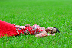Sleeping beauty (A. adnan) Tags: guangzhou china sleeping red green nature girl beautiful grass pose nikon asia dress 85mm guangdong srilanka lying srilankan nikon85mmf18d gettyimageschinaq12012