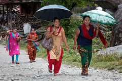 Villigers heading to town, Annapurna region (Michał Olszewski) Tags: nepal people woman umbrella other clothing asia dress traditional parasol land adjectives himalayas brolly tamu ethnicity gurung acap gandaki kaski birethanti ethnicgroup annapurnaconservationarea annapurnaconservationareaproject