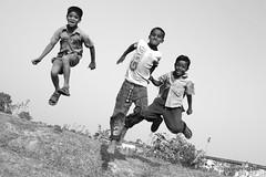 Flying High (mahmud.rassel) Tags: friends boy people blackandwhite boys childhood kids contrast rural canon festive children fun happy kid child bongo joy lifestyle happiness bangladesh bangla bengali bangladeshi bangali banga canon450d flickraward unconditionaljoy mahmudrassel mohammadrasselmahmud