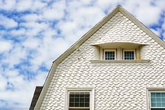 Shingled House (parmo) Tags: sky house boston clouds ma shotgun newton zuiko50mmf18