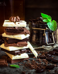 Chocolate / Chocolate bar / chocolate background/chocolate tower and glass with chocolate beans decorated with mint leaf. (azimavu) Tags: chocolate sweet sweets dessert background food candy delicious brown cocoa dark gourmet tasty eat assortment snack chocolates gift sugar macro black cream bonbon bar milk cinnamon bitter ingredient calorie confectionery wooden cacao fat tower white jar mint nut many group stack piece texture hazelnut closeup broken slice
