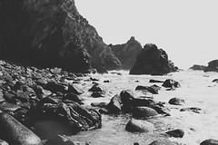 (aclaudine) Tags: sea blackandwhite praia beach portugal nature water digital canon landscape rocks sintra naturallight da ursa