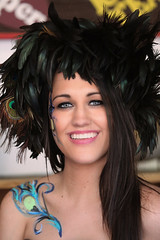 Fairest Smile In The Land (wyojones) Tags: texas texasrenaissancefestival toddmission texasrenfest renfest renfaire renaissancefaire faire renaissancefestival festival trf girl woman brunette maiden wench cute pretty lovely gorgeous beautiful beauty blueeyes smile lips redlips feathers facepaint bodypaint