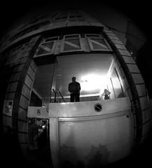 The observer (Monigote Valencia) Tags: window valencia ventana calle demonstration mirar through manifestacion hombre mirando seor observer indiscreta