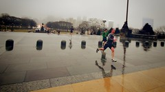 a Race in the Rain (Neo - nimajus) Tags: city reflection men philadelphia sports rain youth stairs race pennsylvania rocky running pa artmuseum jogging raining puddles camerabag phily rockybalboa