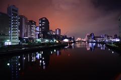 Koushoku (amber) (Andrew W.....) Tags: city bridge light sky building water japan night clouds buildings river dark tokyo bay amber nikon william andrew awc cornwell shinigawa d7000