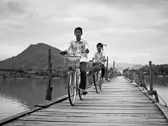 Crossing the Bridge, Somewhere near Nha Trang (adde adesokan) Tags: street travel people pen photography asia streetphotography documentary olympus vietnam ep3 streetphotographer m43 mft mirrorless microfourthirds theblackstar mirrorlesscamera streettogs addeadesokan