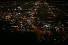 2012_02_13_bos-phx-slc_95 (dsearls) Tags: city arizona black phoenix night flying aviation aerial downtownphoenix windowseat usairways windowshot anthropocene 20120213