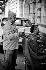 The street Barber (Marwa Morgan) Tags: life africa old city urban blackandwhite haircut detail brick face car hair nikon downtown head cut traditional bricks egypt citylife culture documentary christian arabic cairo arab barber egyptian vehicle tradition egitto egypte afrique  streetbarber d90 maronite lecaire  egyptianpeople  100weshwwesh 100faceandface egyptianfaces 18105mmf3556gii greaveyar facesfromegypt