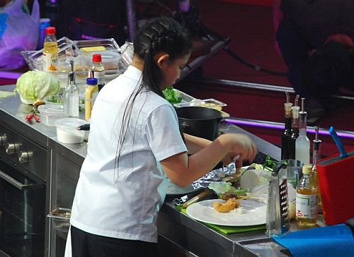 Mika prepares her dream dish, gin-dori in soy mix with seafood furai at the Junior MasterChef Pinoy Edition The Live Cook-off