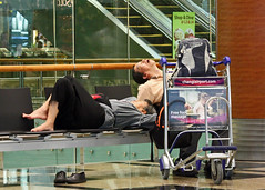 Jet Lag Perfection (seddeg ~) Tags: travel woman man airport singapore sleep luggage exhaustion fatigue travelers jetlag sleepinginairports awakeallnight asleepintheday desynchronosis img71941 changia hopetheangleprovidesthemsomefacialanonymity waitingforafreefootmassage