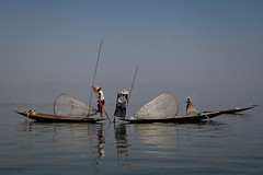 Fishing on Inle Lake (Lil [Kristen Elsby]) Tags: travel blue lake net boat fishing fisherman asia fishermen burma topv1111 bama canoe getty editorial myanmar inlelake 7020028l 247028l skiff burmese gettyimages fishingnet intha travelphotography 2470f28l myanma canon5dmarkii gettyimagesonflickr myanmar2012