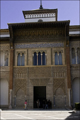 Mudejar Palace (Peter I Palace or Don Pedro's Palace) (Greatest Paka Photography) Tags: travel art history architecture facade tile ceramic spain arch decorative patterns islam columns royal courtyard palace seville frieze alcazar moors portal column monarchy donpedro mudejar castile voussoirs realalcazar monteros corbels peteri spandrels kuficscript royalalcazar kingpeteriofcastile