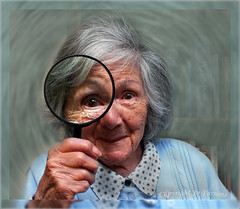 Searching for Clues. (jo92photos) Tags: old portrait england senior smiling fun reading eyes fuji grandmother humour hobby magnifyingglass puzzle explore elderly browneyes granny magnify clue havingfun solve eyeglass pensioner hs20 allrightsreserved myfuji searchingforclues challengegamewinner jo92photos sparkleineye giveusyourbestshot hs20exr 522012week15 solvingcrossword readingaid