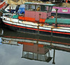 Going Nowhere (littlestschnauzer) Tags: old uk pink red white west reflection green water colors up boats boat canal still interesting cabin nikon long colours character yorkshire nowhere pipe rusty going used wharf wakefield colourful rotten decrepit tethered waterway exhaust corroded moored d5000