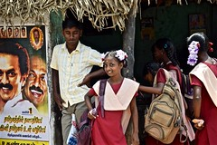 """""""Here I Come Bollywood"""" (The Spirit of the World) Tags: flowers portrait india children fun ribbons asia candid jasmine streetscene posters schoolchildren electionposters southernindia schooluniforms"""