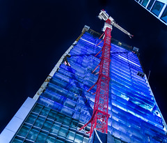 181 fremont rising to 70 stories (pbo31) Tags: sanfrancisco california city blue urban panorama black color vertical skyline architecture night evening construction nikon crane may large panoramic fremont highrise bayarea tilt residential stitched lean 181 2016 transitterminal boury pbo31 d810 financialdistrictsouth