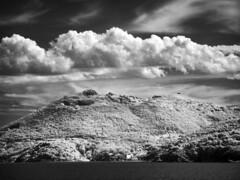 Elba island from the sea (Giorgio Verdiani) Tags: sky costa tower clouds ir coast nuvole nightshot sony grain filter cielo infrared fortress 8mp h9 fortezza grana giove irfilter digitalgrain bridgecamera dsch9 granadigitale
