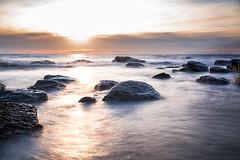 Sunset Glow Over Marino Rocks (Caramel Kisses Photography) Tags: ocean sunset sea seascape beach water clouds canon rocks waves glow australia slowshutter adelaide southaustralia neutraldensityfilter marinorocks creamywaves