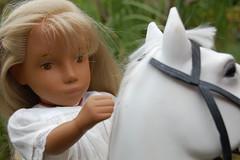 Sara and her white horse (Emily1957) Tags: sara sashadoll sashadolls doll dolls toys toy whitedress whitehorse gotz vintage toyhorse horse battat closeup vinyl plastic eyes handpainted handpaintedeyes bridle light naturallight nikond40 nikon kitlens oo