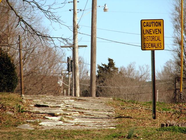 Caution Uneven Historical Sidewalks