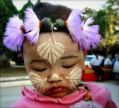 Myanmar - Febbraio 2012 (anton.it) Tags: foglie child rosa occhi myanmar fiori bocca bambina volto coloro dipinto colorato canong10 antonit mygearandme