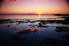 Sunset reflections (n.pantazis) Tags: sea sky sun clouds reflections coast rocks streetlamps greece voula pentaxkx nd4 colorgradation gcwine