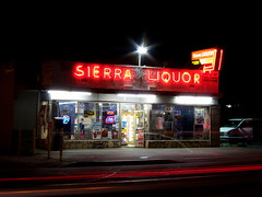 Sierra Liquor (tobysx70) Tags: california ca light toby sign shop night digital canon store neon phone nocturnal tail trails powershot sierra illuminated liquor headlight lit hancock avenue fontana s90 canonpowershots90 canons90 tobyhancock sierraliquor