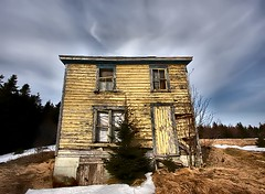 Abandoned (Karen_Chappell) Tags: old blue winter sky house snow canada tree abandoned yellow newfoundland forgotten weathered nfld logybay