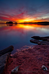 Night Fire (John Cothron) Tags: autumn sunset sky usa cloud sun color reflection fall nature rock 35mm canon georgia landscape twilight outdoor dusk gainesville sunny lakeshore ze lakelanier lowwaterlevel hallcounty mountainviewpark brownsbridgeroad johncothron 5dmkii distagont2821 cothronphotography zeissdistagont21mm28ze