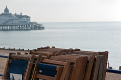 WAITING  (Colour version) (DESPITE STRAIGHT LINES) Tags: england people beach sunrise seaside nikon waiting chairs bikes bicycles eastbourne bandstand eastsussex deckchairs nikon75300mm eastbourneseafront d700 nikond700 ilobsterit