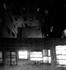 A Funny Book (ChelseaBoothe) Tags: nyc winter blackandwhite window night canon photography alley diptych overexposed 2012 xsi