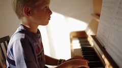 Cinema Picture Style (Hans Hoffnung) Tags: boy 2 music cinema playing sunshine canon john eos hope kid child play profile piano picture style 1d 7d instrument 5d lesson setting magichour 44 helios 600d 550d 60d t2i t1i cineplus