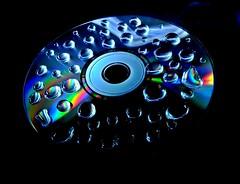 SOUNDS LIKE MUSIC TO ME... (Nakeli) Tags: longexposure water waterdrop cd multicolor