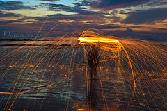 Steel wool Lanta (Chrisseee) Tags: longexposure travel sunset sky orange reflection beach clouds canon circle landscape spiral thailand fire evening asia sparkle burning kohlanta spinning lowtide krabi steelwool klongdao kristiinahillerstrm chrisseee
