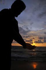 Colombo - Preserving The Sun (eternal_ag0ny) Tags: sunset sea sky cloud holiday reflection beach silhouette seaside nikon friend colorful sri lanka nikkor colombo 18200mm d300s