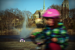 how quickly childhood goes by... (glhs279) Tags: lake motion blur fountain bicycle newjersey spring pond nikon play cathedral essexcounty basilica helmet nj vivid newark branchbrookpark tricylce cathedralbasilicaofthesacredheart d600
