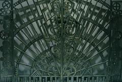 Portal Of Profit (MPnormaleye) Tags: door art metal design 1930s gate circles patterns wheels moderne scuplture grille deco gears chevron zigzag