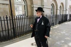 #06 Pin stripe (Doowopski) Tags: street hat streetphotography bowtie cigar suit railings pinstripe dapper hatwearer doowopski streetrepeat106