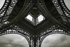Up the Eiffel Tower (Origin_AL) Tags: travel sky blackandwhite bw paris france tower geometric monochrome metal clouds shapes landmark structure symmetry gustaveeiffel d610 1635mm