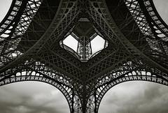 Up the Eiffel Tower (Origin_AL) Tags: travel sky blackandwhite bw paris france tower geometric monochrome metal clouds shapes landmark structure symmetry gustaveeiffel d610 1635mm