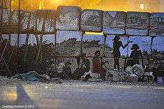 Let Us See The Sunlight (Jonathan Rashad) Tags: wall square photography graffiti al mural downtown jonathan no egypt photojournalism murals moi cairo revolution egyptian journalism ammar uprising abo qasr mubarak alaa tahrir intifada rashad scaf bakr awad ainy