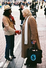 A moment of Connection (Anthony Cronin) Tags: ireland analog superia irelanddublin inner street fuji irishlife street 200 dublinlife dublin dublinirish streetsdublin dublinliving dunne tpastreet dublinirelandnikonf8050mmf14d50mmf14danthonycroninallrightsreservedirishphotographystreetsdublinstreetphotographystreetsofdublin photangoirl
