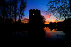 Sunset Tower (jammo s) Tags: old city longexposure trees sunset reflection tower silhouette night river tripod medieval norwich middleages manfrotto sigma1020mm wensum cowtower jammo canoneos60d medievalnorwich
