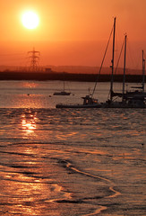 Sunset (emilylb) Tags: pink sunset sea england sky orange sun seascape reflection water river landscape boats island photography boat kent haze warm pretty horizon panasonic level ripples mast hazy hazey mere solei batau pilon sheppy a as dmctz10 emilylb