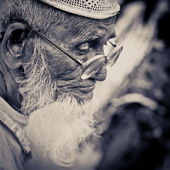 The one (Shutterfreak ☮) Tags: street old portrait man monochrome death glasses pain nikon beards dhaka nikkor sorrow wrinkles bangladesh 35mmf18 hasin d5000 inkiad